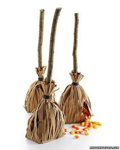 My how-to: get 2 brown paper bags and cut to desired height. Cut one bag into strips (all sides but the bottom). Put treat in uncut bag, then wrap cut bag around that. I like to use a carmel apple for the treat and have the stick in the apple double as the broom stick.