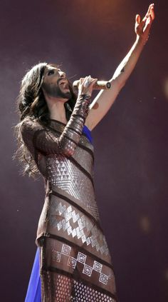 Conchita Wurst winner of the 2014 Eurovision Song Contest.  The world's most famous bearded lady wearing one of the hottest assiut dresses ever! Designed by Gaultier - http://youtu.be/qz9CglUXLjI