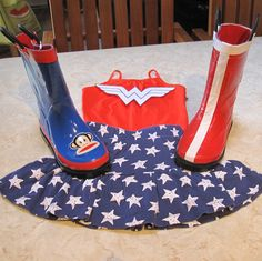 I am just starting the Wonder Woman costume and wanted to show this photo before I covered second boot.  Shoes are quite often the draw back of any costume but I think I solved the boot problem for this one.  Just bought this rain boot on clearance.  I already had red and white duck tape. It's far from perfect but for a 4 year old to wear to a birthday party it will be fine. This idea will work for many Halloween costumes plus it will keep the kids feet warm and dry.