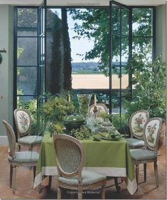 The former barn, with its steel doors, was transformed into an orangery. Fabric by Le Manach.