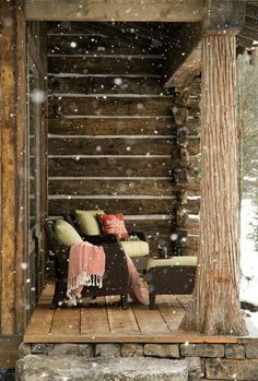 sitting on the cabin porch and drinking coffee, while snow is falling gently on the ground.