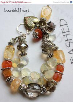 charm bracelet, chunky chain bracelet, multi strand bracelet, heart bracelet, vintage charm bracelet....Moment of Truth. $55.99, via Etsy.