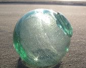 glass fishing float in an Etsy treasury!  check it out!