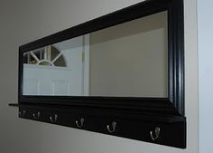DIY entryway mirror with hooks and shelf