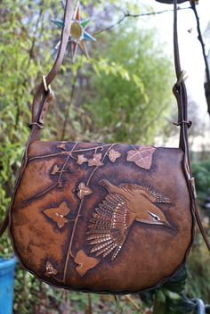 Wayland Boho > elaborately carved boho style bag with wrens and ivy leaves from skyravenwolf.com