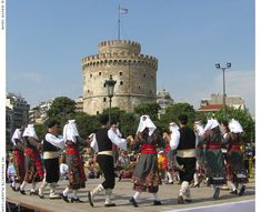 Macedonian dancers perform in front of Thessaloniki's seafront Lefkos Pirgos (White Tower) Macedonia Greece, London Summer, The Cheshire, Light My Fire, Alexander The Great, Baby Coming, Thessaloniki, Summer Olympics, Traditional Outfits