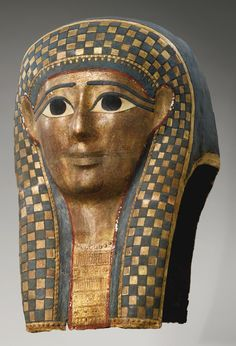 AN EGYPTIAN POLYCHROME AND GILT CARTONNAGE MUMMY MASK, LATE PTOLEMAIC PERIOD, CIRCA 100-30 B.C.