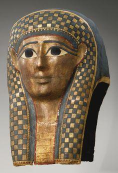AN EGYPTIAN POLYCHROME AND GILT CARTONNAGE MUMMY MASK, LATE PTOLEMAIC PERIOD, CIRCA 100-30 B.C.