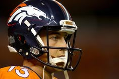 Trevor Siemian Photos Photos - Quarterback Trevor Siemian #13 of the Denver Broncos looks on as the Broncos take on the Carolina Panthers at Sports Authority Field at Mile High on September 8, 2016 in Denver, Colorado. - Carolina Panthers v Denver Broncos