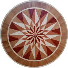 #woodfloormedallion made by Rose Farm Inlays.  Hardwoods used in the geometric floor medallion are Curly White maple, Flaming Red Padauk, Tiete Rosewood and African Mahogany
