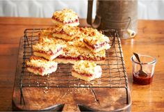 Delicious afternoon tea snack served nicely with tea or coffee. Raspberry Coconut Slice, Coconut Jam, Lemon Slice, Yummy Treats, Sweet Treats, Yummy Food, Cake Stall, How To Make Biscuits, Tea Snacks