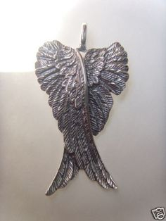 Have a very similar Angel Wings Pendant but mine is silver and more variation between mostly shiny and black..love it