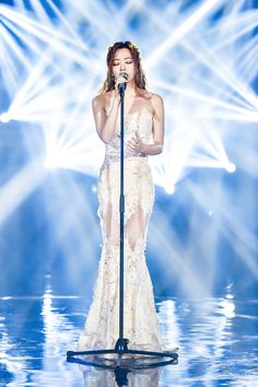 "The fabulous Jane Zhang mesmerized the audience during her guest appearance at the ""I am singer"" Chinese TV Show in a white lace Tony Ward Couture gown from the Fall Winter 2014/15 Collection"