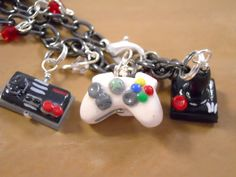 Video Game Charm Bracelet—The bracelets feature six controllers, some old-school, some newer: Atari, the original NES, Sega Genesis, Playstation, Wii, and XBox 360. What's really cool about the bracelets is that the artist can customize them or even swap out a controller you don't like for one you love!