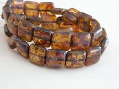 Translucent Amber with a brown Picasso finish Czech pressed glass beads by Sparkling Sisters Jewelry Supplies on Etsy, $3.95