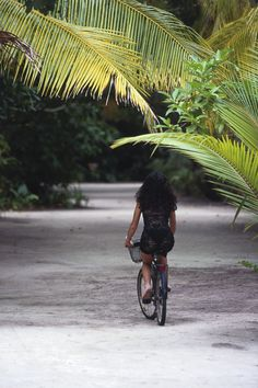 Soneva Fushi - everyone gets their own bike to whisk around the island