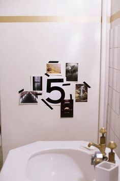 parisian interiors bathroom with collage on wall