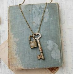 Worn blue book with old lock and key - I think I'll try to paint some of my old book covers to try to get this look.
