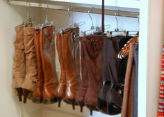 Use pant hangers with sliding clips to hang your boots! Sweet!