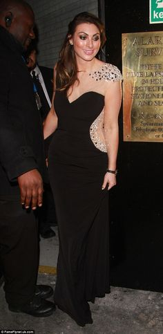 Glamorous: The former Celebrity Big Brother star was all dolled up in her floor-length dre...