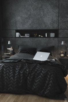 Dark, chic bedroom decor perfect for snoozing.