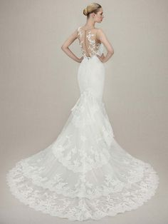 Stunning lace illusion gown from the 2016 Enzoani collection. Just arrived!