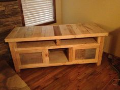 making a TV stand out of pallets.  Nice!