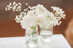 inexpensive #wedding flower arrangements for #reception tables: baby's breath, roses in mason jars