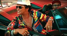 """Bruno Mars' New Single '24K Magic' Picks Up The Funk Check out the blinged out video too   Hashtag blessed! Bruno Mars just released his new single """"24K Magic"""" in advance of his new album of the same name, due on November 18. The new track picks up right where """"Uptown Funk"""" left off. It's 70s grooves, glitchy synths and pseudo-rap verses prove Mars is a throwback pop pro! He also revealed the the album cover and the song's music video below."""