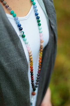 Bring all of the chakras into perfect balance and manifest any intention with the chakra rising mala. Made with a beautiful combination of twenty-one different types of precious gemstones, silver and
