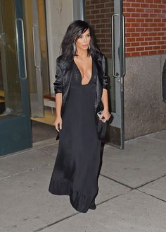 She wears a silk, shawl-collar blazer and black pleated maxi dress during an evening out in New York City.   - MarieClaire.com