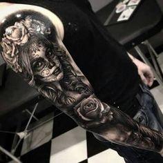 115 Santa Muerte Magnificent ideas for the unique tattoo designs Tattoo L, Skull Girl Tattoo, Skull Sleeve Tattoos, Sugar Skull Tattoos, Best Sleeve Tattoos, Tattoo Sleeve Designs, Leg Tattoos, Body Art Tattoos, Girl Tattoos