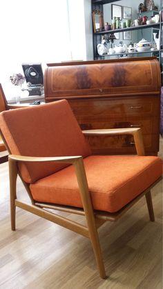 sweden style lounge chair.vintage furniture for living room .scandinavian modern,orange matireals, organic form,