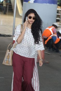 Keerthy Suresh, who is all set to make her big Bollywood debut, nailed her girl next door look as she was papped at the Hyderabad airport. Girl Next Door Look, Indian Heroine, National Film Awards, She Girl, Beautiful Girl Photo, Most Beautiful Indian Actress, Maroon Color, South Indian Actress, Keerti Suresh
