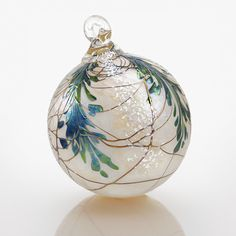 Evergreen Heirloom by Bryce Dimitruk. Sumptuous pine boughs trimmed with gold drape this pearly blown glass ornament with luminous color. An Artful Home exclusive. Christmas Ornaments To Make, Christmas Balls, Christmas Art, Christmas Decorations, Christmas Ideas, Christmas Things, Peacock Christmas, Coastal Christmas, Modern Christmas