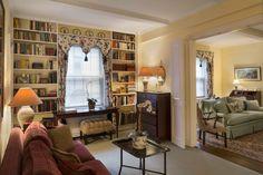 lovely built-in bookshelves in a sitting room.