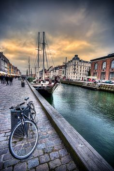 some of my favorite things: a bike, sailboat, water, cobblestone walkway: Copenhagen