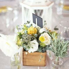 Yellow and grey rustic wedding. wooden flower boxes, yellow and cream flowers. Flowers by www botanica-flowers.co.za and photography by www.abbyanderson.co.za
