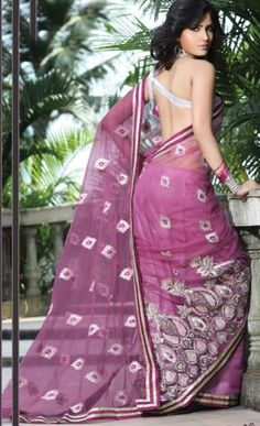 Pink Color Net Saree.  Saree is crafted with sequins, resham, zari and patch work.  Fabric - Net.  Color - Pink.  Length of sarees with attached blouse pc. is 6.25 mtrs.  Costume/Outfit - Saree with Blouse piece.          #Sarees_online #Designer_Sarees #Indian_sarees