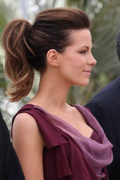 "Kate Beckinsale looks radiant in a Christian Dior Fall 2010 plum and rose ensemble during a jury photocall at Cannes. The ""Underworld"" actress is taking her place alongside President of the Jury, director Tim Burton and Italian actress Giovanna Mezzogiorno on the judging panel for the 63rd Cannes Film Festival. The event took place at the Palais des Festivals on the famous Croisette in Cannes."