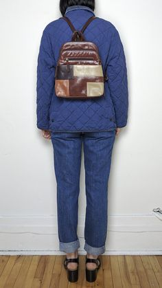 90s leather patchwork mini-backpack in perfect condition. Adjustable straps with zipper, so it can also be worn as a shoulder bag.  Brand: Veneto Materials: 100% leather, lined with synthetic fabric Made in: unlisted Number of pockets: One main zipped pocket with interior zipper. Second zipped section, front zipped pocket.  Width: 10.5 Height: 11.5 Depth: 3.25   Have questions? Please feel free to contact me.  Thank you