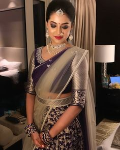 In a bridal look in dark purple color floral saree, elbow length sleeve blouse design, hip band, necklace, head piece / maang tikka and jewelry Lehenga Designs, Wedding Saree Blouse Designs, Pattu Saree Blouse Designs, Half Saree Designs, Saree Blouse Patterns, Fancy Blouse Designs, Saree Wedding, Blouse Lehenga, Half Saree Lehenga