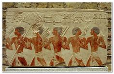 """Relief from the temple of Hatshepsut showing Egyptian soldiers  Parade of Egyptian soldiers during the """"Beautiful Feast of the Valley"""".  18th dynasty, 1479-1458 BC.  Limestone.  From Thebes, Deir el-Bahri.  33 x 58,5 cm."""