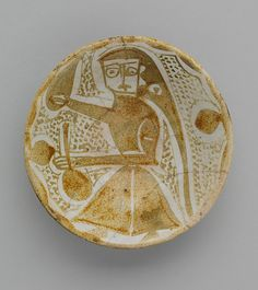 Imported Luster Bowl Object Name : Bowl  Date : 10th century  Geography : Iran, Nishapur; Iraq  Culture : Islamic  Medium : Earthenware; luster-painted on an opaque white glaze