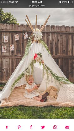 Love the extra floral and green touches to this teepee