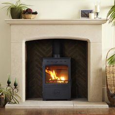 That's it, we've decided - Portland Stone fire surround :) Wood Burner Fireplace, Fireplace Kits, Stone Fireplace Surround, Fireplace Hearth, Fireplace Design, Fire Surround, Parlor Room, Classic Fireplace, Front Rooms