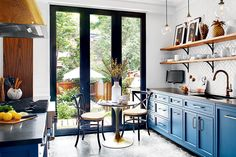 Colour, pattern and texture mingle in this historical Montreal semi's upbeat French bistro-style kitchen.