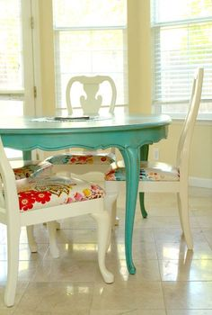 turquoise table and funky chairs Look for odd chairs and tables to repaint and repurpose at thrift stores, antique shops and yard sales