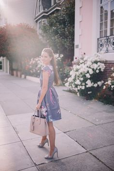 Gal Meets Glam Wall of Roses - Ted Baker dress, Salvatore Ferragamo pumps, and Prada bag.