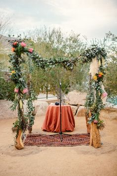 flower and eucalyptus ceremony arch, photo by Sweet Little Photographs http://ruffledblog.com/modern-palm-springs-wedding #altars #ceremonies #wedding